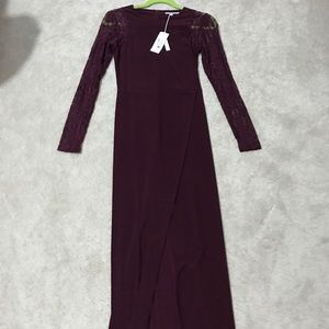 Burgundy gown with slit.